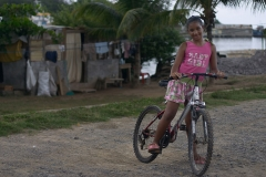 Girl with a Bicycle in Roatan, Honduras