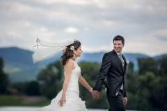 Wedding Couple Walking in Wind