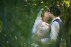 Bride and Groom Cuddling in a Forest in Lower-Austria