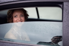 Bride in a Car, Groom in Reflection